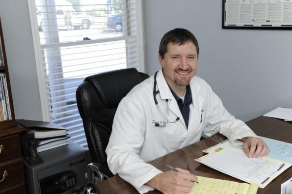 Dr Alford at Desk RS_473834f9-5094-4248-b2e0-501275780f1c